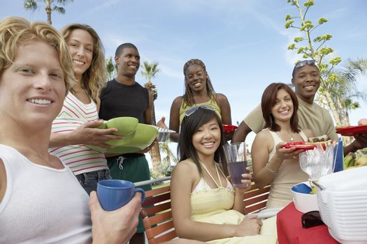 Young people eating outside in summer