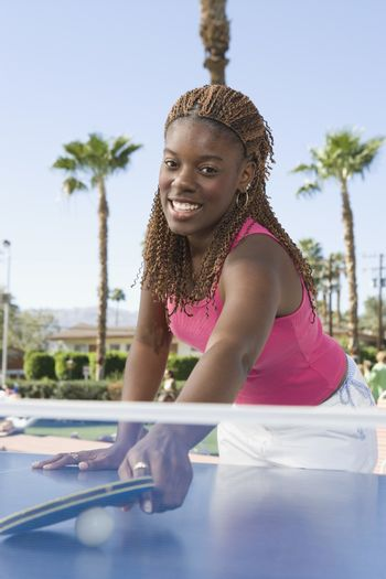 Portrait of an African American woman playing table tennis