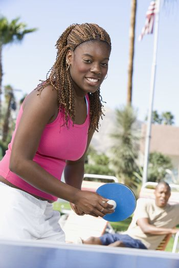 Portrait of an African American female playing table tennis