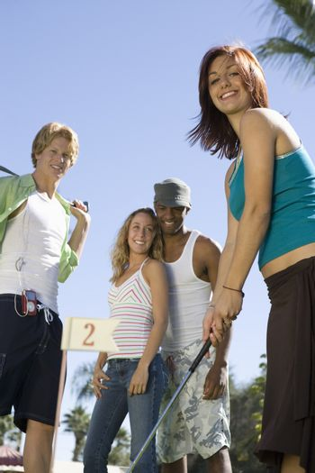 Woman Playing Golf With Friends