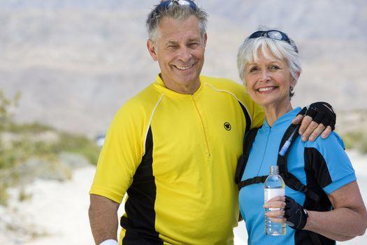 Portrait of a happy senior couple in sportswear