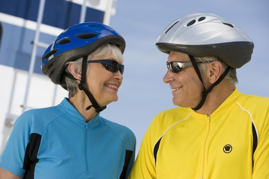 Happy senior couple in sportswear looking at each other