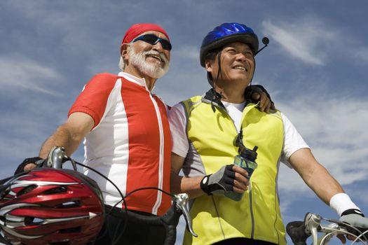 Two Senior men with bikes