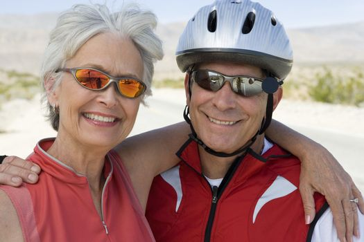 Portrait of a happy senior couple in sports uniform