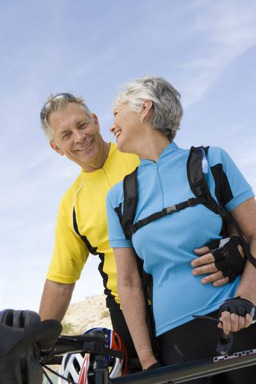 Senior couple in sportswear smiling