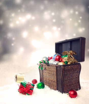 Treasure box filled with Christmas ornaments and presents