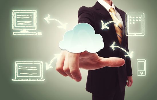 Businessman pressing cloud icon