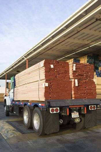 Wooden planks on trailer at warehouse ready for export