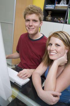 Couple Using Desktop Computer
