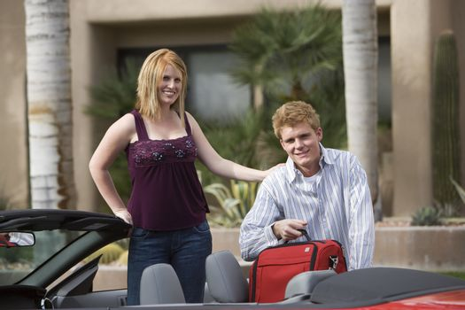 Couple Loading Luggage in Car