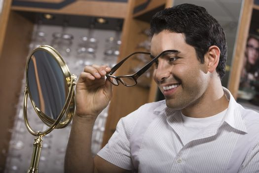 Man trying on eyeglasses in store