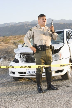 Highway patrol officer at scene of crime