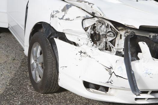 Closeup of a smashed car headlight on desert highway