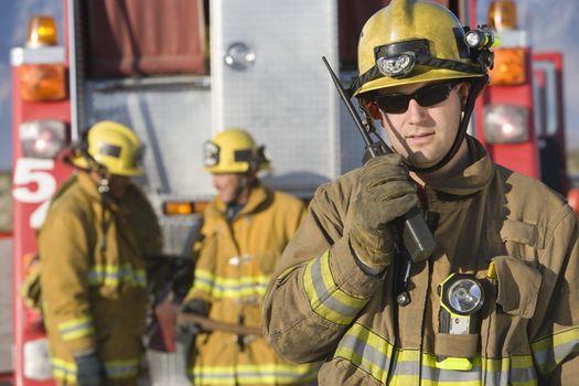 Portrait Of A Firefighter Talking On Radio