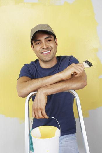 Man with paintbrush and paint can portrait