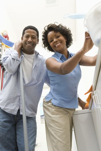 Portrait of an African American couple doing household chores