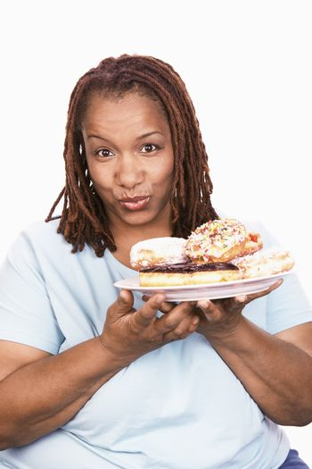 Overweight Woman holding Junk Food portrait