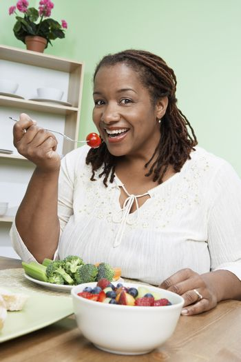 Overweight woman eating healthy food portrait