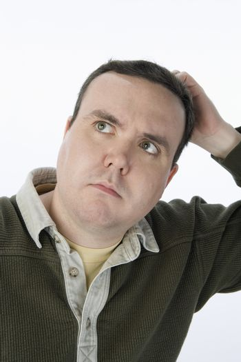 Middle aged man scratching head isolated over white background