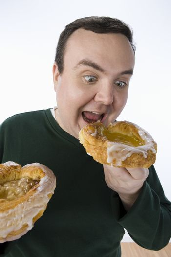Middle aged man having delicious donut