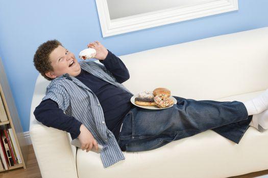 Boy Eating Donuts