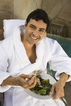 Happy mature man eating healthy food