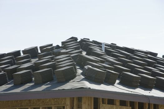 Stack of tiles on roof against clear sky