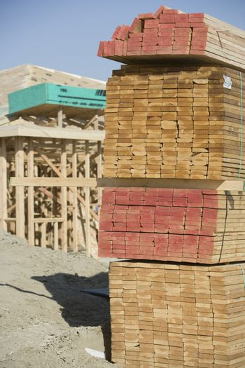 Stack of new wooden beam at construction site