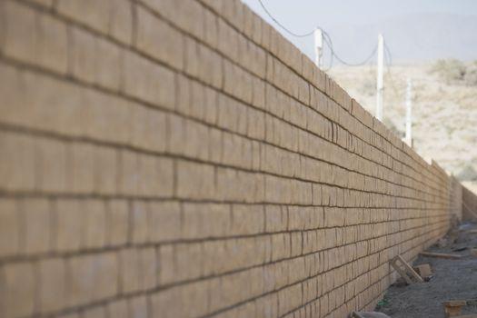 Brick wall at construction site