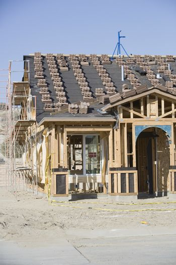 Exterior framework of a wooden house at construction site