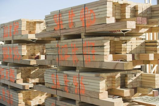 Wooden beams stacked at construction site