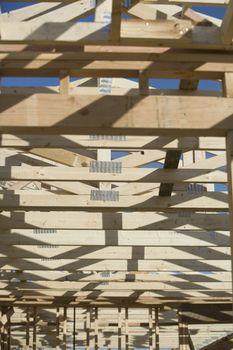Framework of a wooden house under construction