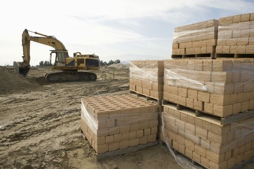 Pile of stacked bricks at construction site