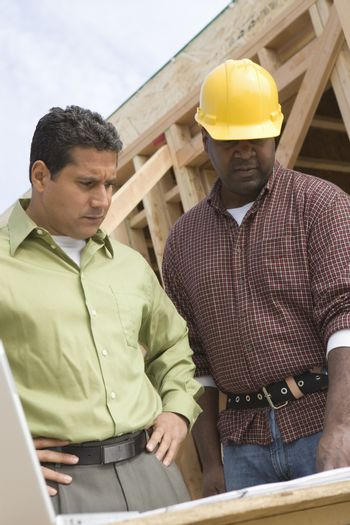 Architects in discussion at construction site