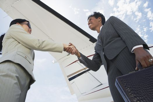 Business Handshake At The Airport