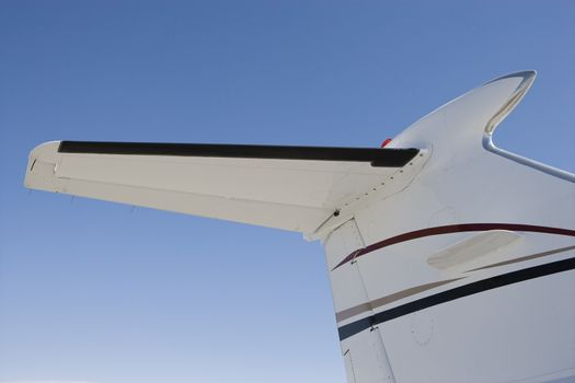 Close up of airplane tail against clear sky