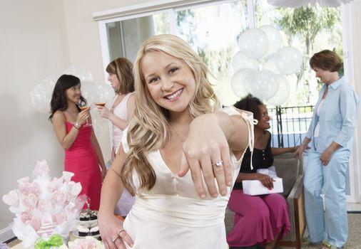 Bride Showing Off Ring at Bridal Shower