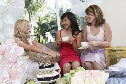Happy bride with her friends at hen party