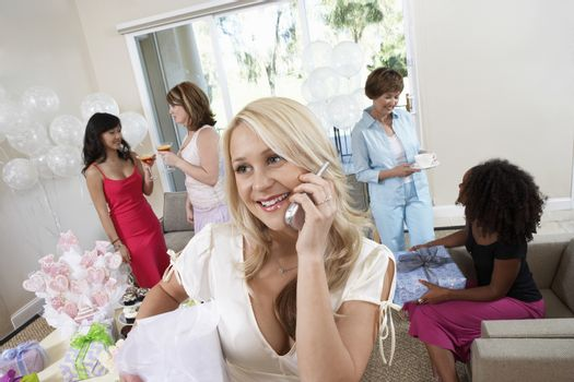 Bride Talking on Cell Phone During Bridal Shower