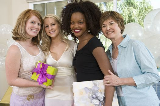 Portrait of happy bride with her friends and mother at hen party