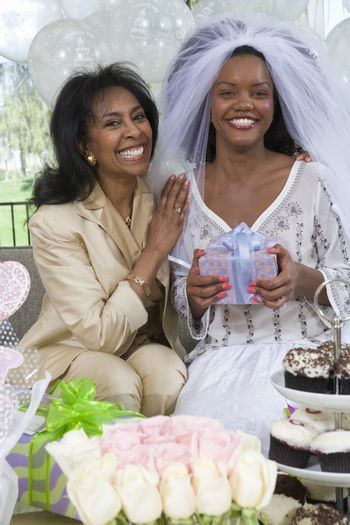 Portrait of happy bride and her mother at hen party