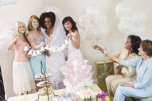 Young woman celebrating bridal shower with friends