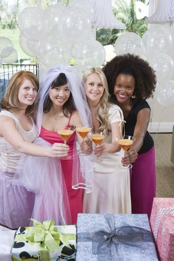 Portrait Of Happy Multi Ethnic Friends Holding Cocktail Glasses At Hen Party