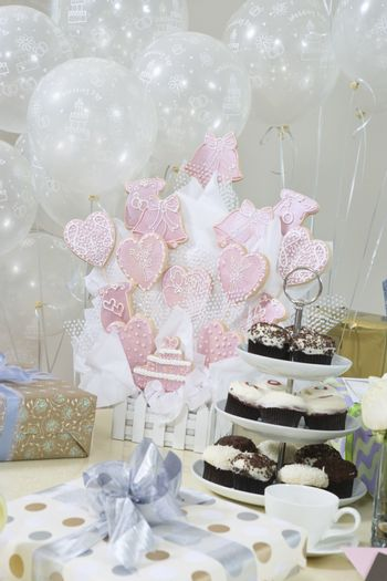 Gifts, decorations and cake stand at hen party