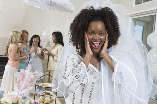 Excited bride wearing veil at bridal shower