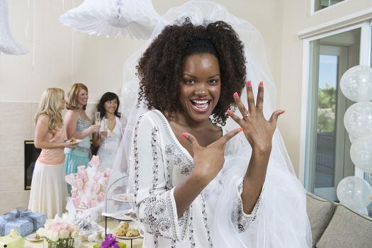 Bride showing her engagement ring at bridal shower