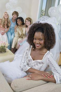 Bride wearing veil at bridal shower