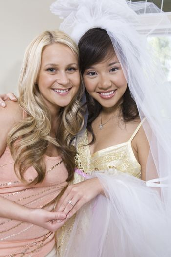 Portrait of happy bride with friend at hen party