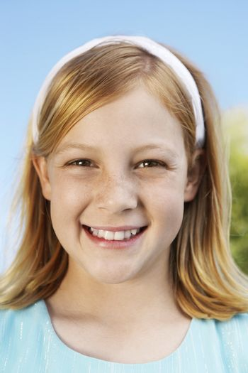 Close up of a teenage girl smiling