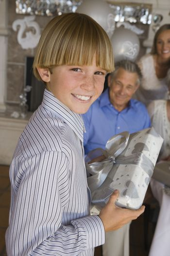 Teenage Boy Holding Gift